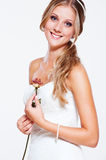 Beautiful smiley bride with rose. Portrait of beautiful smiley bride with rose Royalty Free Stock Photos