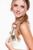 Beautiful smiley bride with rose Royalty Free Stock Photo