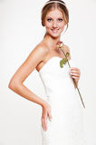 Beautiful smiley bride with rose. Portrait of beautiful smiley bride with rose Royalty Free Stock Photography