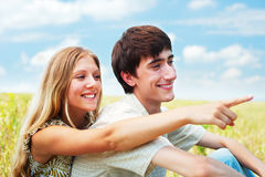 Beautiful smiley couple over blue sky Royalty Free Stock Image