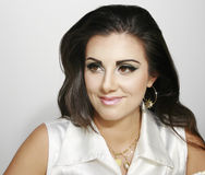Beautiful smiley girl with makeup. Beautiful attractive smiley girl with makeup and earring, long dark hair Stock Image