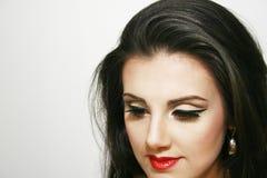 Beautiful smiley girl with makeup. Beautiful attractive smiley girl with makeup and earring, long dark hair Stock Photography