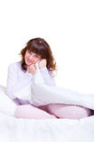 Beautiful smiley woman in the bed Stock Photography
