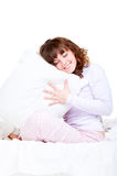 Beautiful smiley woman with pillow Royalty Free Stock Photos
