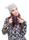 Beautiful smiley woman with winter clothes and mug of coffee Stock Photography