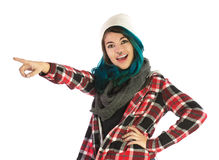 Beautiful smiling and amazed girl pointing forward. On white background. Pierced, turquoise haired and dressing up a plaid shirt Royalty Free Stock Photo