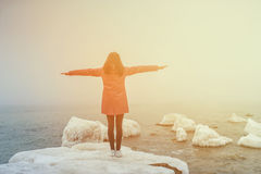 Beautiful smiling with arms outstretched on the beach winter Royalty Free Stock Photography
