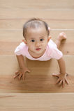 Beautiful smiling asian baby girl while crawling up a stair. Stock Images