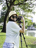Beautiful smiling asian girl with camera Royalty Free Stock Image
