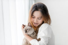Beautiful smiling Asian girl holding her cat Royalty Free Stock Photo