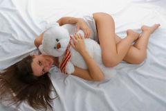 Beautiful smiling asian girl with a toy. Stock Photos