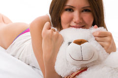Beautiful smiling asian girl with a toy. Royalty Free Stock Photography