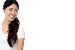 Beautiful smiling asian model looking away Stock Photography
