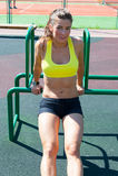 Beautiful smiling athlete woman stretching on playground Royalty Free Stock Photo