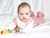 Beautiful smiling baby girl lying royalty free stock photography