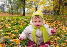 Beautiful smiling baby sitting on royalty free stock image
