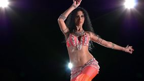 Beautiful, smiling belly dancer continue dancing stock video