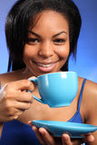 Beautiful smiling black drinking tea Royalty Free Stock Photos