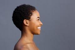 Beautiful smiling black female model against gray background Stock Photos