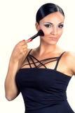 Beautiful smiling black hair girl applying makeup with brush Stock Photo