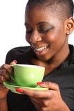 Beautiful smiling black woman drinking cup of tea stock image