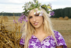 Beautiful smiling blond. Y girl at the nature Royalty Free Stock Photography