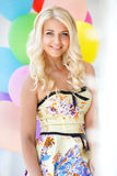 Beautiful smiling blond girl with colorful balloons Royalty Free Stock Images