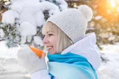 Beautiful smiling blond girl in a sport hat stock photos