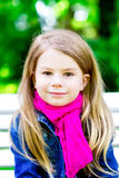 Beautiful smiling blond little girl in the park Royalty Free Stock Photos