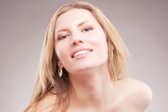 Beautiful smiling blond woman Royalty Free Stock Photos