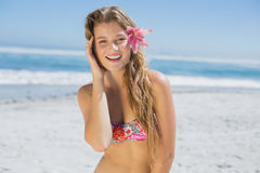 Beautiful smiling blonde with flower hair accessory on the beach Royalty Free Stock Image