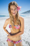 Beautiful smiling blonde with flower hair accessory on the beach Royalty Free Stock Photo