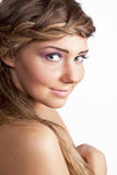 Beautiful smiling blonde girl. Studio portrait of beautiful smiling blonde girl on white background Royalty Free Stock Image