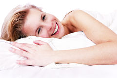 Cheerful blonde girl in bed. Stock Photo