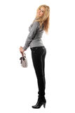 Beautiful smiling blonde with a handbag Royalty Free Stock Photo