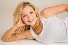Beautiful Smiling Blonde Lying Down and Relaxing Royalty Free Stock Photo