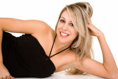 Beautiful Smiling Blonde Lying Down and Relaxing Royalty Free Stock Images