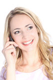 Beautiful smiling blonde talking on mobile phone Stock Photography