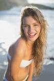 Beautiful smiling blonde in white bikini at the beach Stock Photography