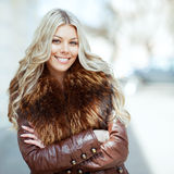 Beautiful smiling blonde woman with arms folded Royalty Free Stock Images