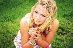 Beautiful smiling blonde woman on the green meadow. Stock Photo