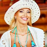 Beautiful smiling blonde woman in hat stock photos