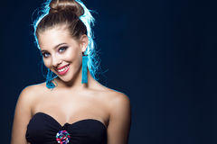 Free Beautiful Smiling Blue-eyed Young Girl With Perfect Make Up Wearing Black Strapless Bra And Blue Tassel Earrings Stock Photos - 97486373