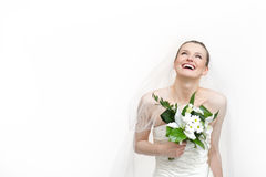 Beautiful smiling bride. Wearing wedding dress. Isolated on white Stock Photo