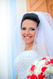 Beautiful smiling bride with bouquet Stock Photography
