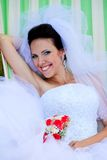 Beautiful smiling bride with bouquet Royalty Free Stock Image