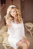 Beautiful smiling bride girl with makeup long wavy hair. Blond w Royalty Free Stock Photography