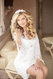 Beautiful smiling bride girl with makeup long wavy hair. Blond Royalty Free Stock Image