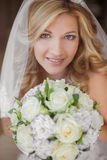 Beautiful smiling bride girl with wedding bouquet of flowers. Stock Photo