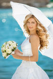Beautiful smiling bride girl in wedding dress with white umbrell Royalty Free Stock Photography